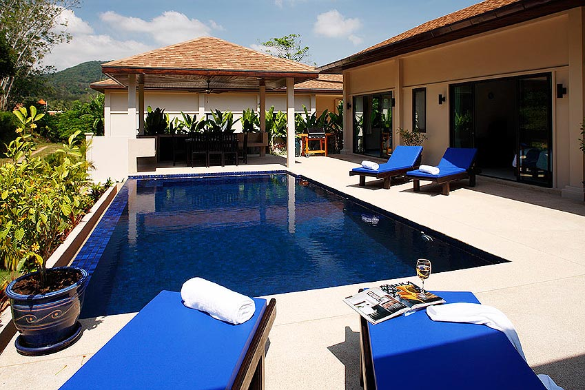 poolside sunbathing gemstone villa nai harn phuket holiday rental