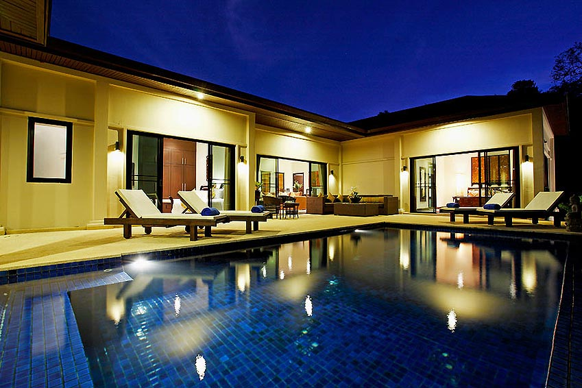 night time relaxation by pool sapphire villa nai harn phuket holiday rental