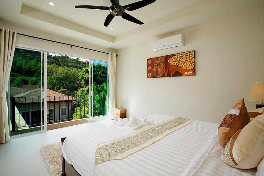 double bedroom with balcony topaz villa nai harn phuket holiday rent