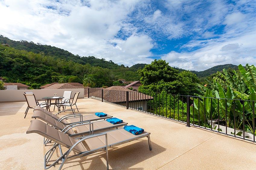 sun deck with sun beds and seating topaz villa nai harn phuket holiday rent