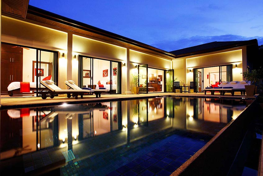 crystal villa nai harn phuket holiday rental nightime entertaining swimming pool
