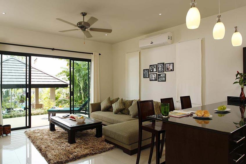 emerald villa nai harn phuket holiday rental living room with balcony lounge tv